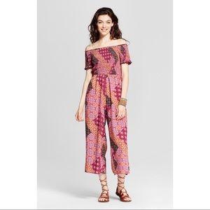 c8e64d0abcb Xhilaration Pants - NWOT Xhilaration floral geometric jumpsuit